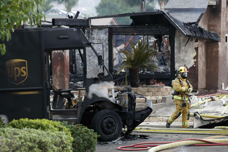 Two people, including a UPS delivery driver, died and two homes were destroyed in the plane crash.
