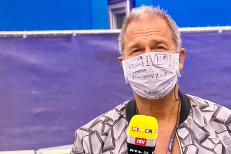 Bei der Formel 1: Kai Ebel mit Mundschutz aus Sachsen