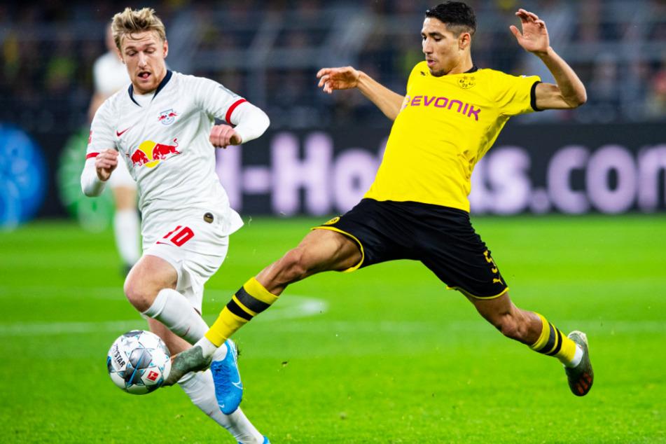 Achraf Hakimi (r.), hier im Duell mit Leipzigs Emil Forsberg, ist von Real Madrid bis zum 30. Juni 2020 an den BVB ausgeliehen.