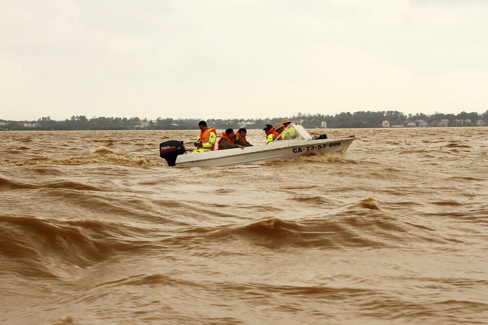 Rescuers on a boat in the flooded region of Quang Binh.