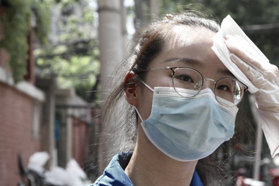 Corona-Ausbruch, zweithöchste Sicherheitsstufe: Peking partiell abgeriegelt!