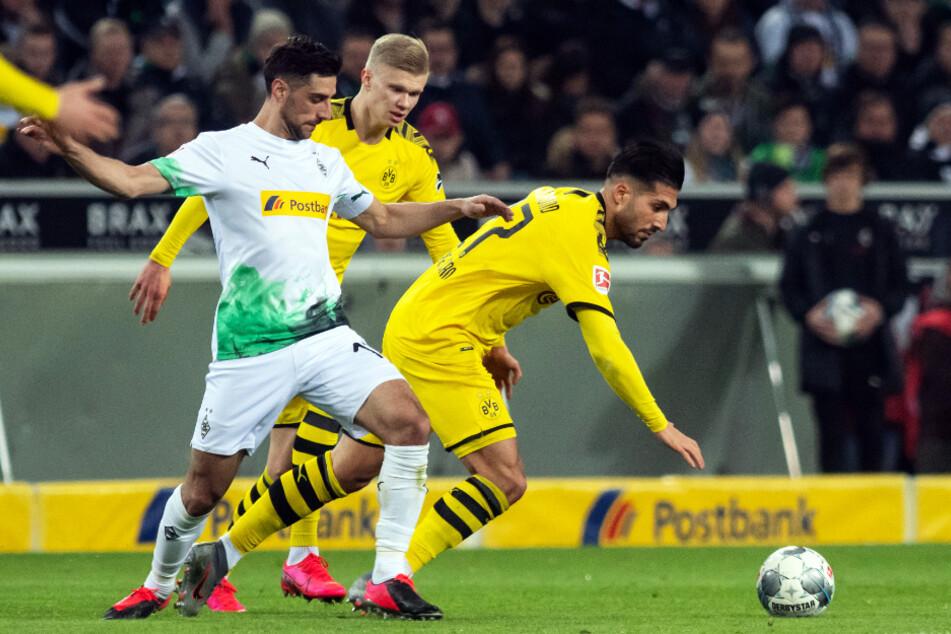 Gladbachs Kapitän und Torschütze Lars Stindl (l.) stieß im ersten Durchgang einmal heftig mit Dortmunds Emre Can (r.) zusammen.