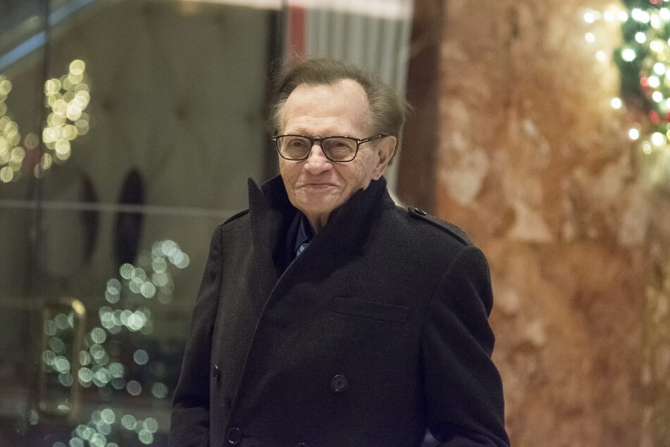 American talk show host Larry King is standing in the lobby of Trump Tower.