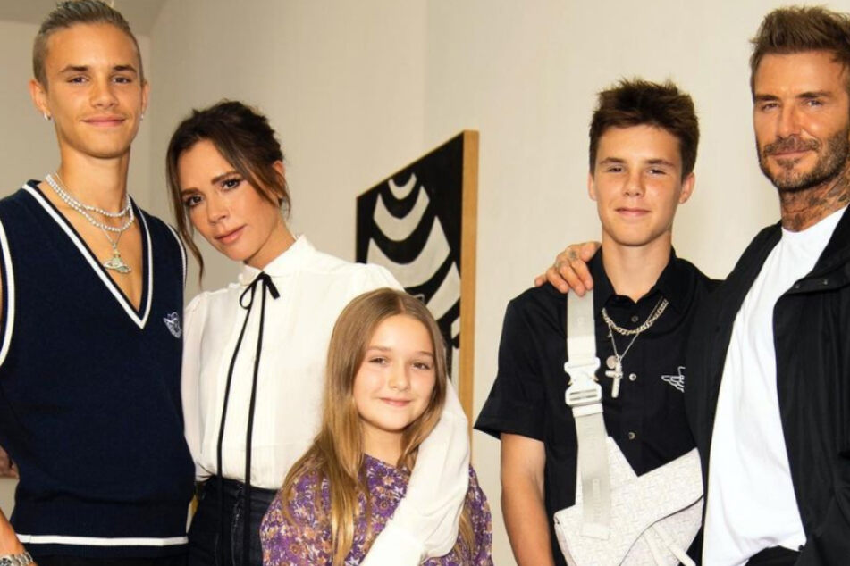 A family photo of the Beckham family.