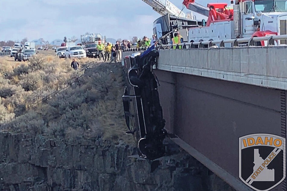 The pick-up truck was in danger of plunging into a 100-foot ravine.