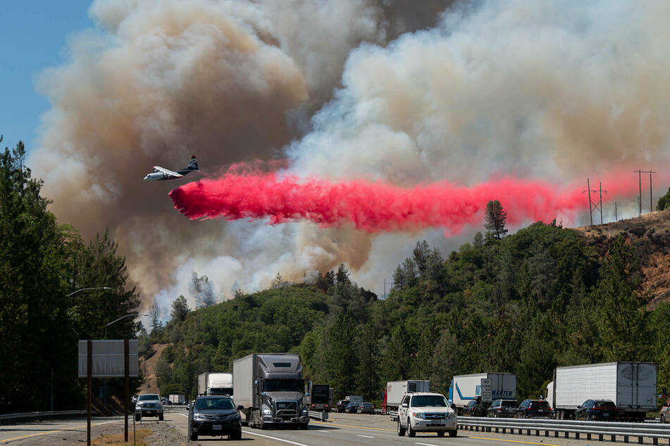 Firefighters battle blazes across California as weather conditions become more critical