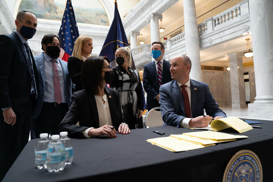 Utah Governor Spencer Cox signed the bill into law on Tuesday, as Paris Hilton watched on.