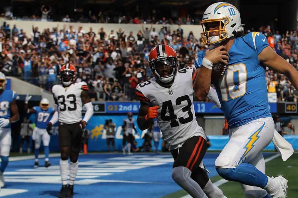 Chargers quarterback Justin Herbert threw four touchdowns and ran for another in LA's win over Cleveland.