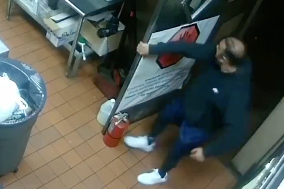Security cameras show Asif Raja using a flammable liquid to set multiple fires in his restaurant.