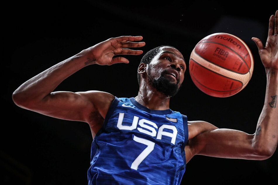 Olympics: US survive scare to down Spain in basketball quarters and set up rematch with Aussies