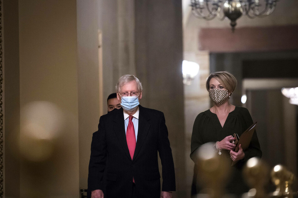 Senate Majority Leader Mitch McConnell walks to the Senate Chamber for a vote on December 21.