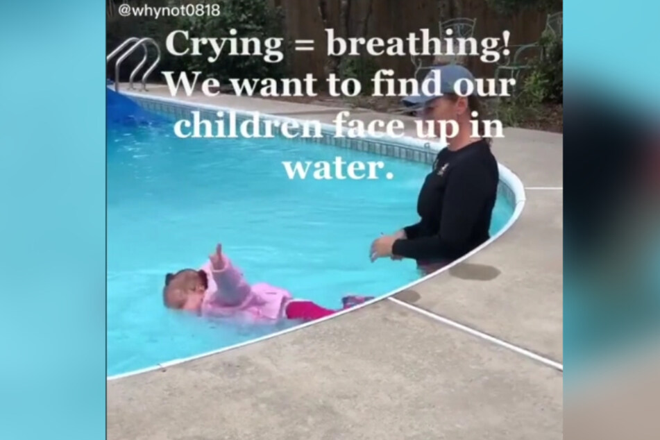 The swimming instructor throws the one-year-old girl into the water.