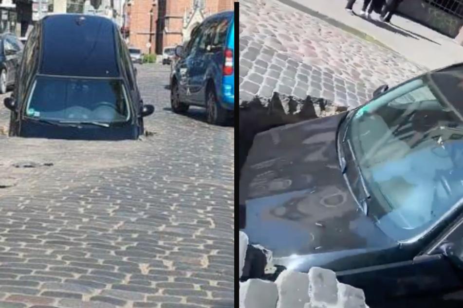 Straße eingebrochen! Auto wird von Loch verschluckt