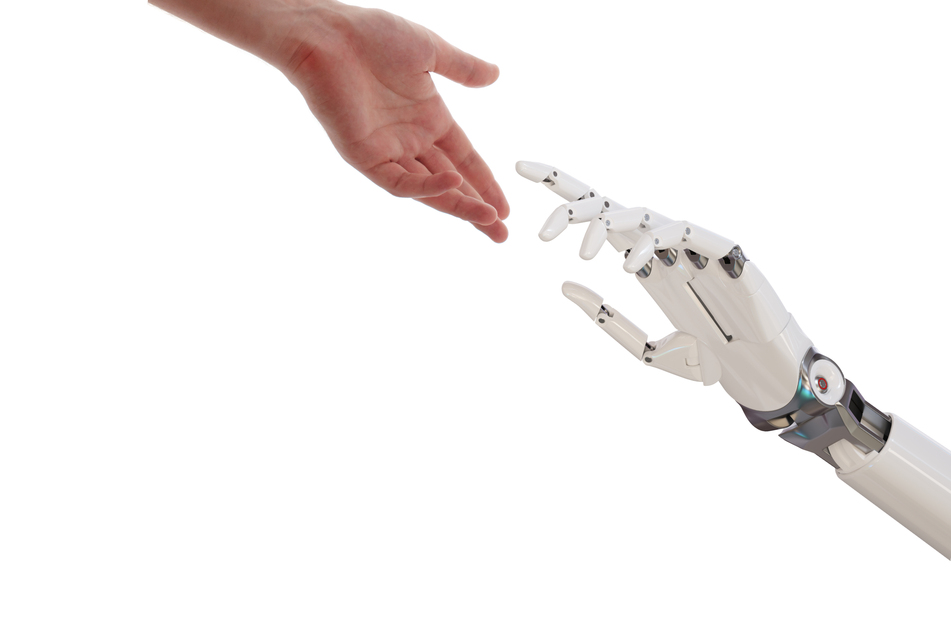 Brain chip gives paralyzed man the ability to feel what a robotic arm touches!
