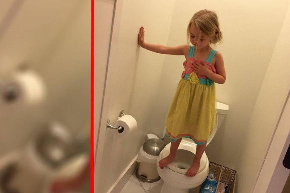 Ein Mädchen steht auf einer Toilette: Der Grund ist schrecklich