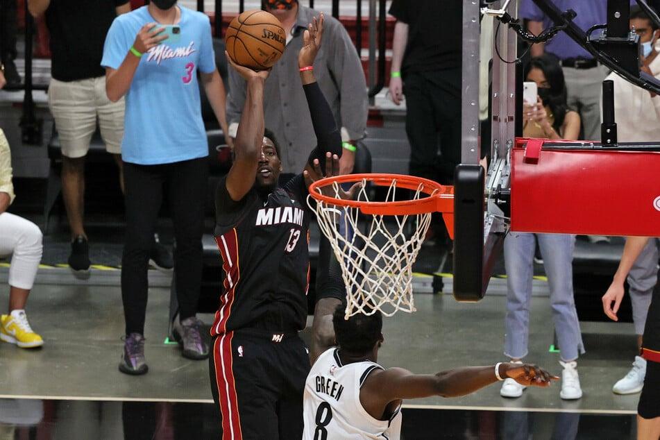 Miami Heat center Bam Adebayo hits the winning shot over Brooklyn Nets forward Jeff Green in the fourth quarter.