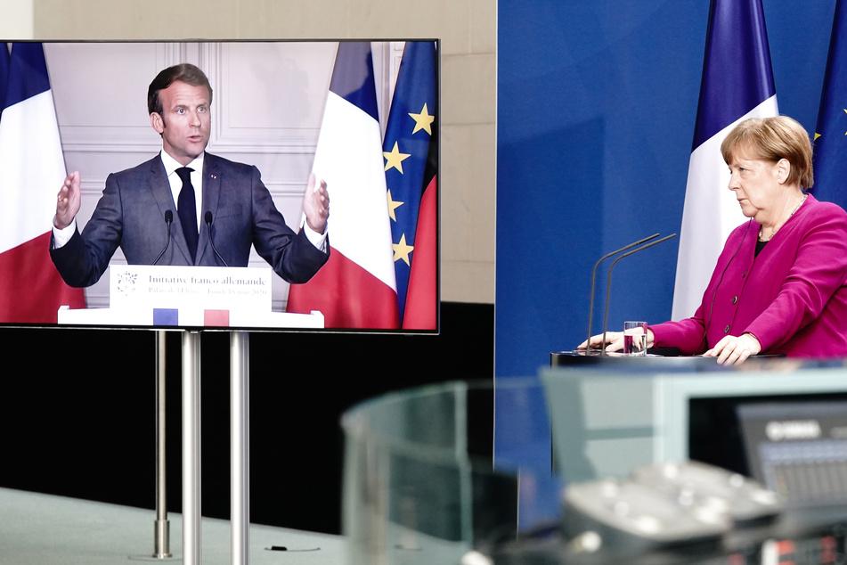 Bundeskanzlerin Angela Merkel (65, CDU) und Frankreichs Präsident Emmanuel Macron (42), per Video zugeschaltet, geben nach einer gemeinsamen Videokonferenz eine Pressekonferenz. (Archivbild)