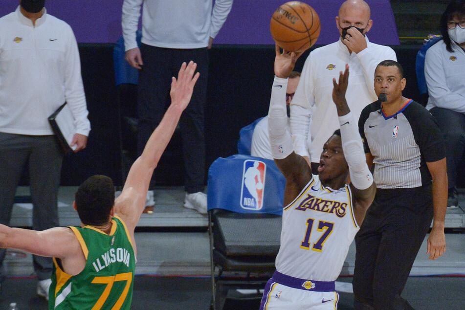 Lakers point guard Dennis Schroder scores over Jazz forward Ersan Ilyasova