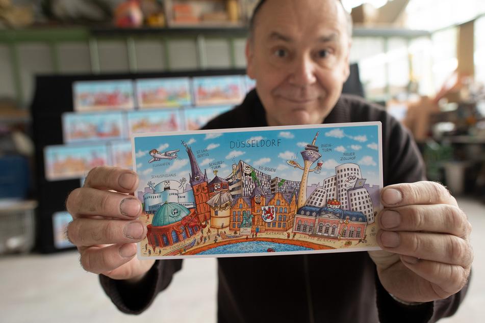 Karnevalswagenbauer Jacques Tilly (57) hat 27 Städte humoristisch porträtiert. Die Bilder sollen demnächst als Postkartenmotive in Bahnhöfen verteilt werden.