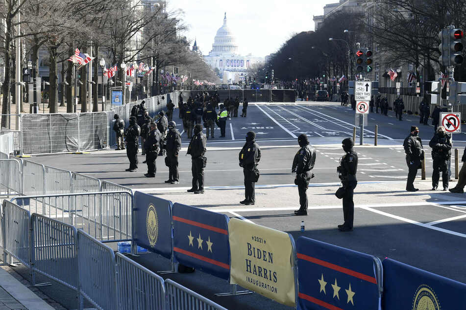 Heavy security stands guard along Pennsylvania Avenue, normally the parade route, on Inauguration Day