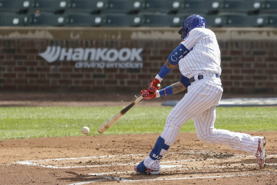 Javier Baez hit a grand slam in the Cubs rout over the Mets on Wednesday
