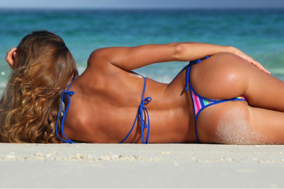 """Die """"Rheinische Riviera"""" wird ab kommender Woche nochmal richtig heiß. Am Sandstrand von Köln-Rodenkirchen kann man das Wetter auch im Bikini nutzen. (Symbolbild)"""
