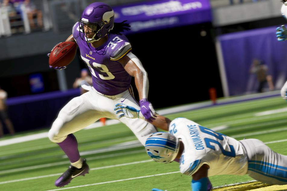 Amani Oruwariye, Cornerback der Detroit Lions, hat keine Chance gegen Running Back Dalvin Cook von den Minnesota Vikings.