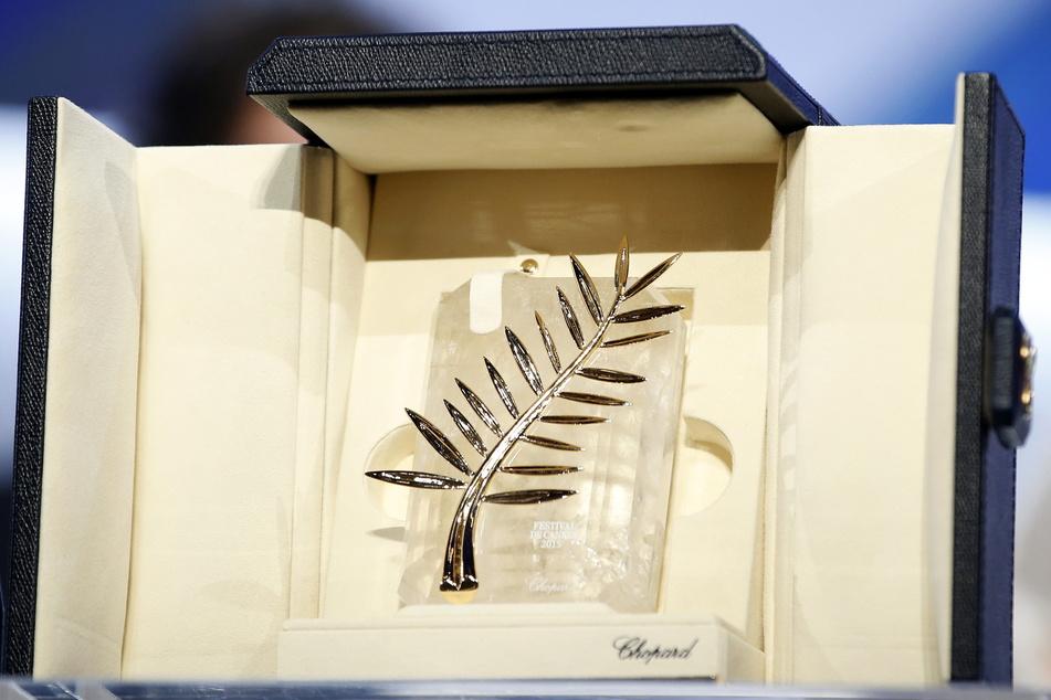 """Die Auszeichnung der Internationalen Filmfestspiele in Cannes, die """"Palme d'or"""" (zu deutsch: Goldene Palme)."""