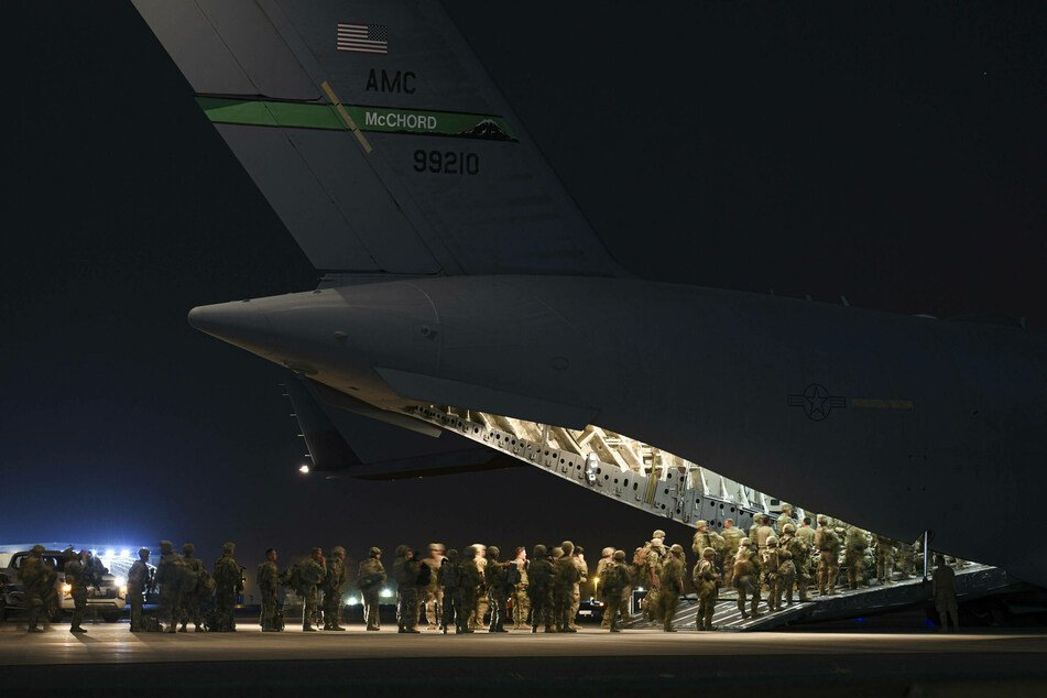 Evacuations of US personnel and Afghans fleeing the incoming Taliban regime continue at Kabul airport.