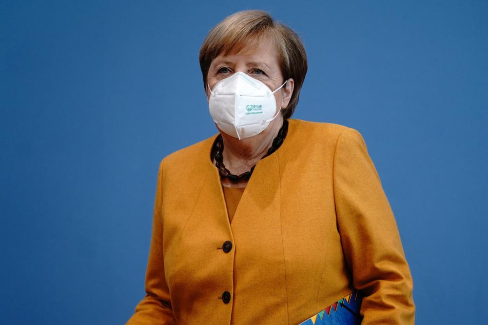 Angela Merkel beantwortet auf einer Pressekonferenz Fragen zu den neuen Corona-Beschränkungen.