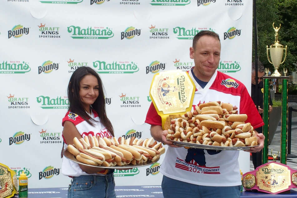 Joey Chestnut breaks own world record to win US Hot Dog Eating Contest