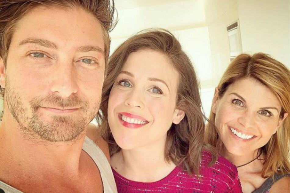Co-stars Daniel Lissing (l.) and Erin Krakow (c.) have never stopped posting support for Lori Loughlin (r.)
