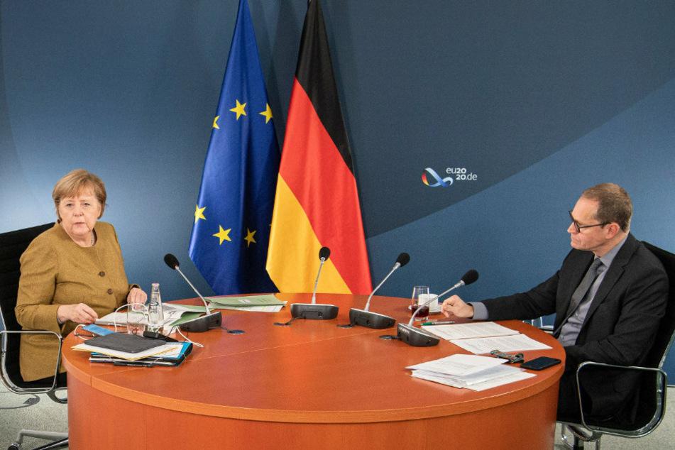 Bundeskanzlerin Angela Merkel (66, CDU, l.) und der Regierende Bürgermeister von Berlin, Michael Müller (55, SPD), zu Beginn der Videokonferenz mit den Ministerpräsident*innen.