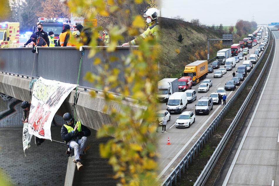 Aktivisten seilen sich von Brücke über A4 ab: SEK holt sie runter!