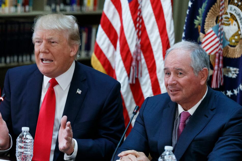 US President Donald Trump alongside Stephen Schwarzman, the chairman of the investment firm Blackstone.