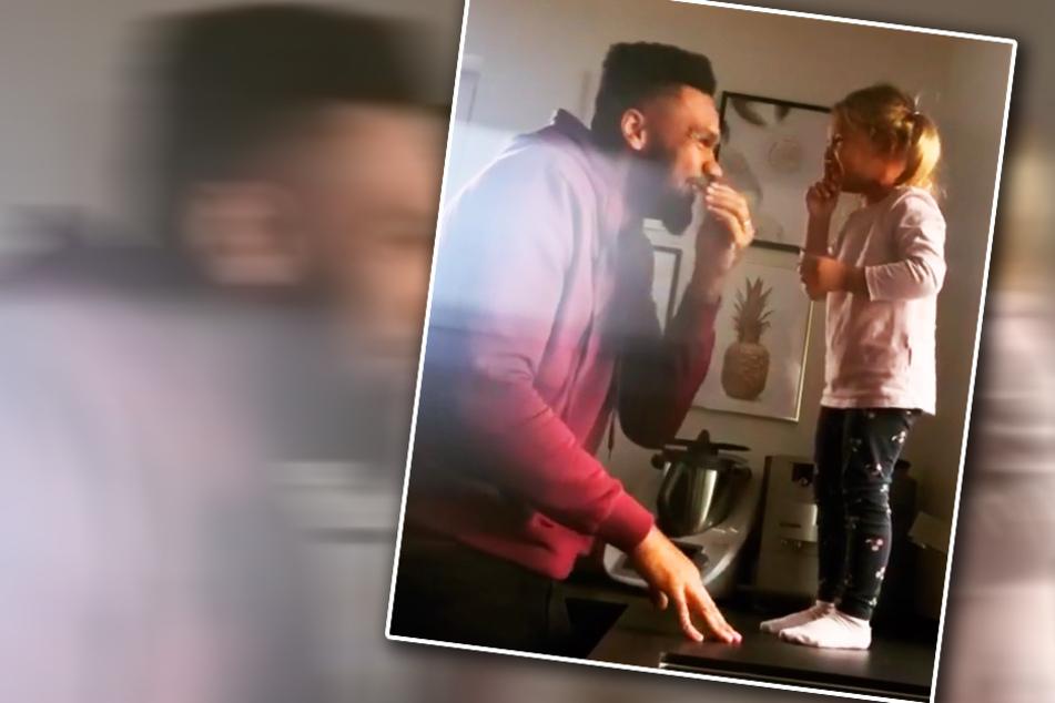 """Zuckersüßer Lachanfall: Dominic Harrison im """"Kusskampf"""" mit Töchterchen Mia Rose"""