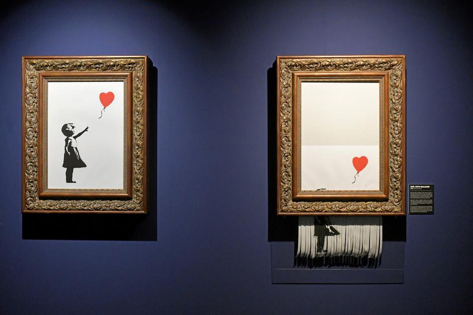 """Provokation in Kopie: Nach der Versteigerung des Bildes """"Girl with Balloon"""" zerschredderte Banksy sein Werk zur Hälfte."""