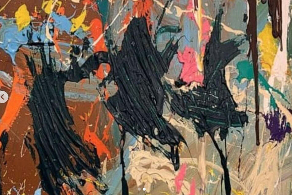 American artist JonOne's mural was accidentally splattered with dark paint by a couple at an exhibition because they mistook the painting for participatory art.