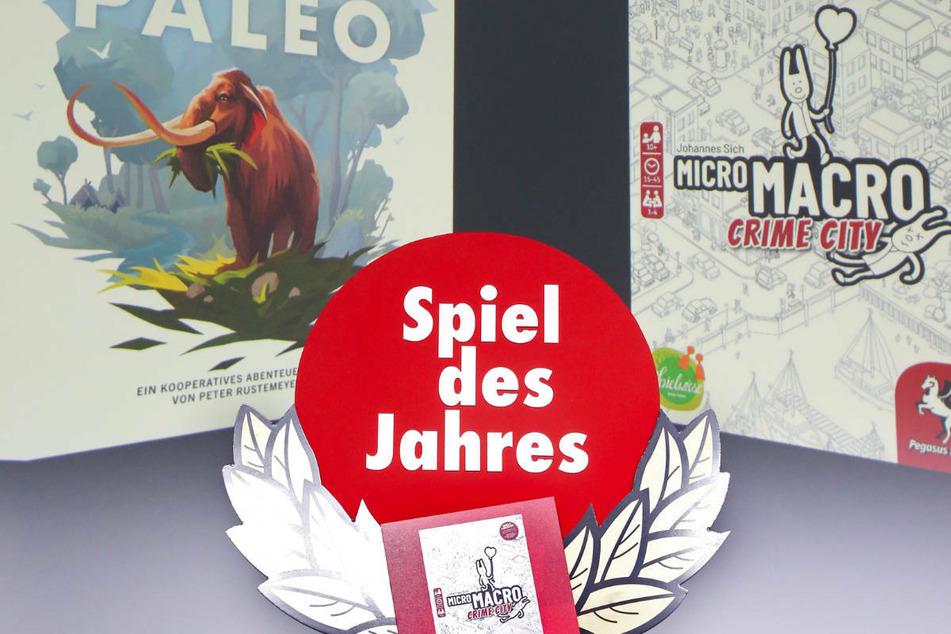 """""""MicroMacro: Crime City"""" von Johannes Sich ist von einer Jury zum Spiel des Jahres 2021 gewählt worden. Mit dem Titel Kennerspiel des Jahres wurde """"Paleo"""" von Peter Rustemeyer prämiert."""