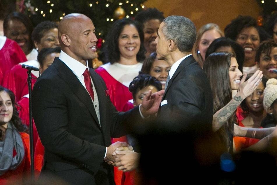 "Dwayne ""The Rock"" Johnson shakes hands with former President Barack Obama."