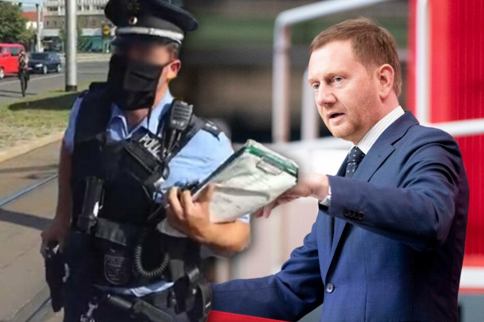Michael Kretschmer (CDU), Ministerpräsident von Sachsen, verteidigt das Verhalten des Polizei-Einsatzleiters (l.).
