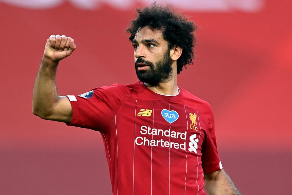 """Liverpools Mohamed """"Mo"""" Salah (28) half einem Obdachlosen gleich zweifach."""