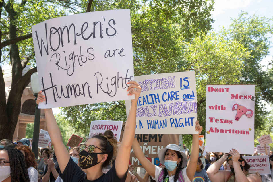 Women rally at the Texas State Capitol in protest of an abortion ban that was signed into law by Governor Greg Abbott.