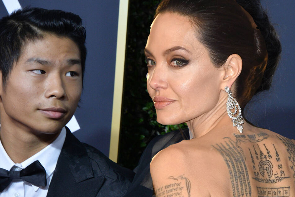 Angelina Jolie (r) has added another tattoo to her growing collection. She was spotted with the new ink on Tuesday in New York City while visiting her ex-husband with son Pax (l).