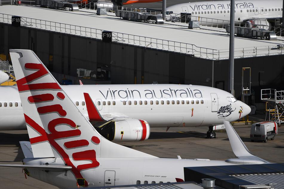 Flugzeuge der Virgin Australia stehen am Flughafen Tullamarine am Boden.