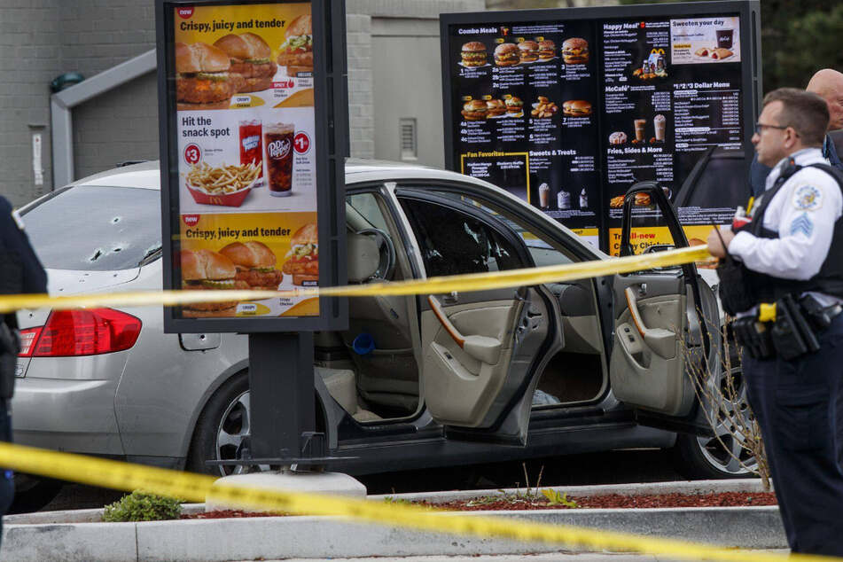 Photos from the scene showed bullet holes in the back windshield of the victims' car in the McDonald's drive-through.