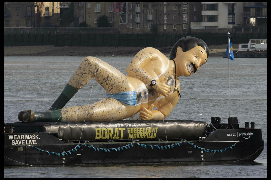 Borat is back: 40-foot-tall plastic doll floating down the Thames