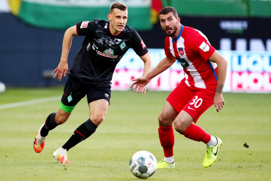 Norman Theuerkauf (r.) erzielte ein extrem unglückliches Eigentor und brachte seinen Ex-Klub Werder Bremen damit mit 1:0 in Führung.