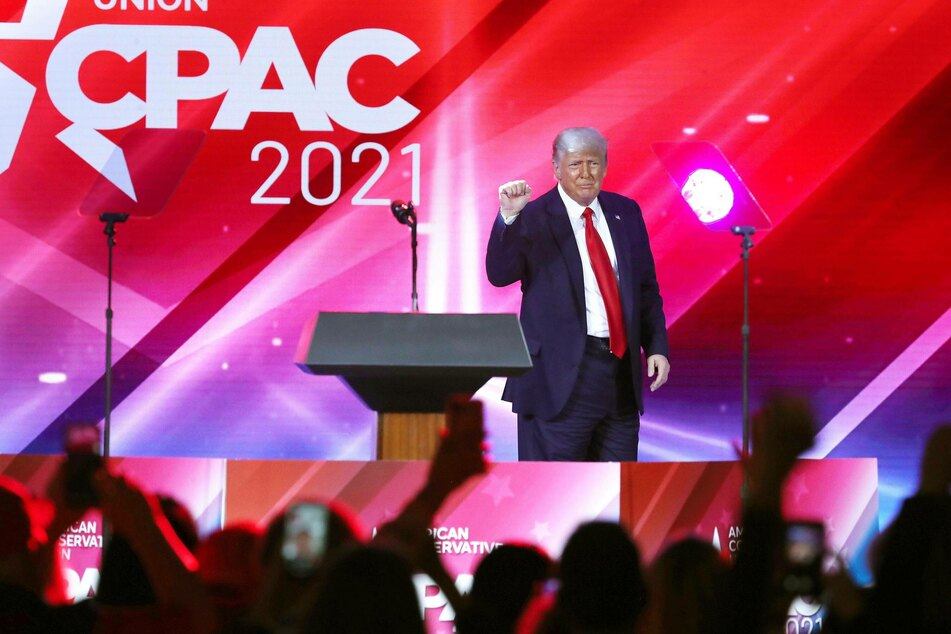 The audience cheers as former President Donald Trump finishes his speech during CPAC at the Hyatt Regency in Orlando, Florida