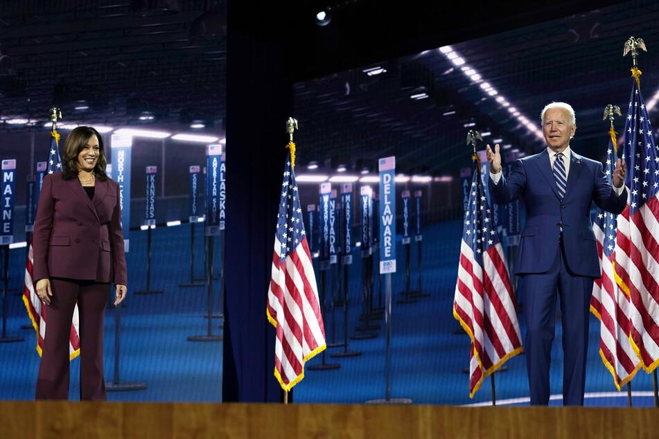 Joe Biden (77), the Democratic presidential candidate, and Kamala Harris (55), the Democratic vice presidential candidate, on stage during the Democratic Convention.